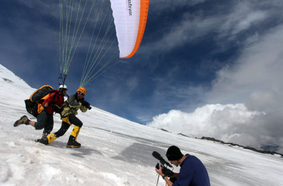 Kyle going for a test flight with Pierre from the high camp back down to base camp.  pic MARIANNE SCHWANKHART