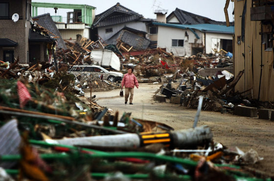 Residents walk through Natori city to find anything left in their destroyed houses